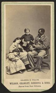 Learning is wealth. Wilson, Charley, Rebecca, and Rosa. Slaves from New Orleans  Charles Paxson, photographer c1864 1 photographic print on carte de visite mount : albumen ; 10 x 6 cm. Photograph shows Wilson Chinn, Charles Taylor, Rebecca Huger, and Rosina Downs, sitting, reading books Library of Congress