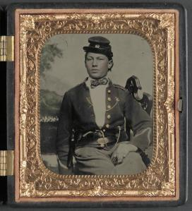 Unidentified soldier of the 26th New York Infantry Regiment with revolver in front of painted backdrop showing camp scene ca. 1861-63 1 photograph : sixth-plate ambrotype, hand-colored ; 9.4 x 8.4 cm (case) Library of Congress