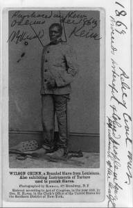 Wilson Chinn, a branded slave from Louisiana--Also exhibiting instruments of torture used to punish slaves c1863 carte de visite Library of Congress